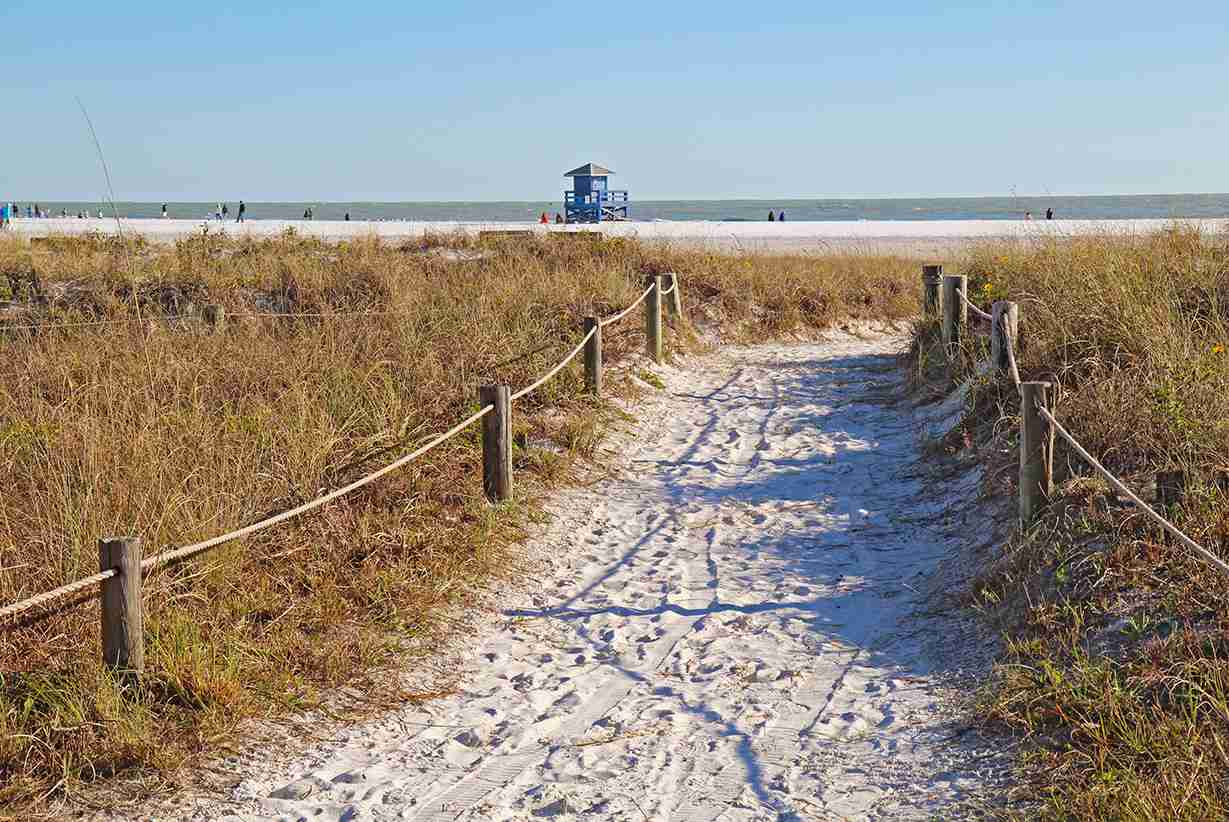 Walkway to the white sand beach and lifeguard station at Siesta Key Beach near Sarasota Florida